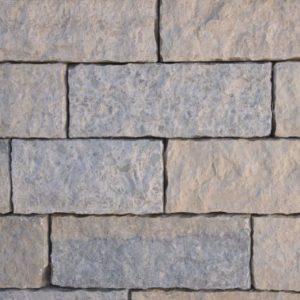 Mauerstein Kalkstein Bayadere, 4 Seiten gesägt, 2 Seiten gespalten und 1 Seite bossiert